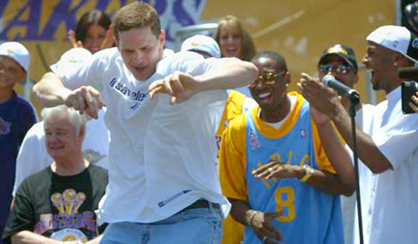 048657.SP.0614.lakers7.AMR The Los Angeles Lakers celebrated their 3rd NBA Championship with a parade and celebration in downtown LA. The celebration ended at the Staples Center. Mark Madsen dances for the crowd at Staples Center.